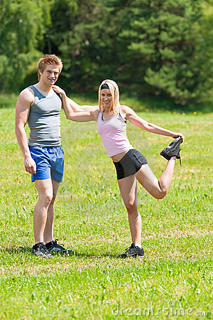 Sportive happy couple in meadows sunny day