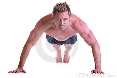 Sportive muscular man doing Push-up workout