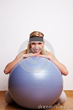 Sportive woman behind gym ball