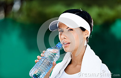 Sportive woman with bottle of water
