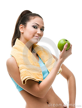 Sportive woman hands green apple
