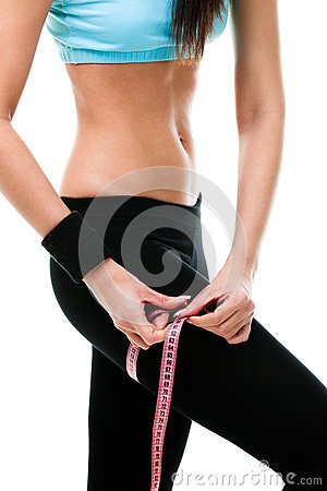 Sportive woman measures her leg