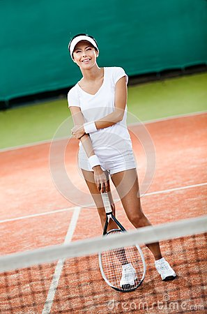 Sportive woman at the tennis court