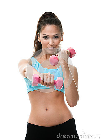 Sportive woman works out with dumbbells