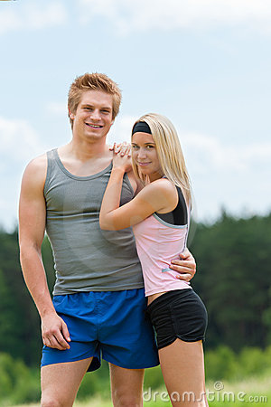 Sportive young couple happy posing in countryside