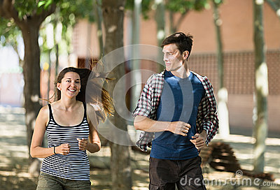 Sportive young couple running outdoor