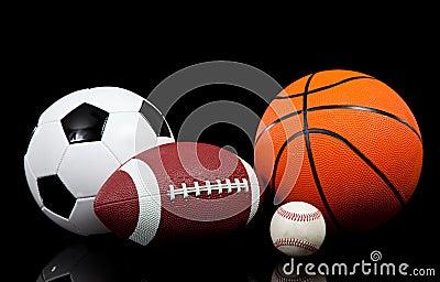 Sports balls on a black background