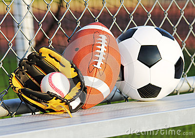 Sports balls. Soccer ball, american football and baseball in glove. Outdoors