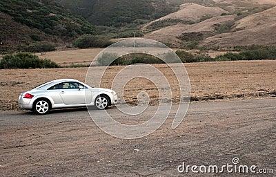 Sports Car on Dirt Road