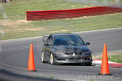 Sports Car driving on Race Course