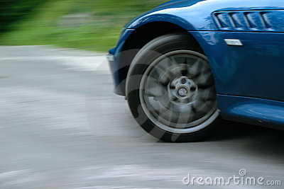 Sports car front wheel spinning and turning