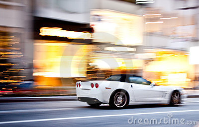 A sports car in motion blur