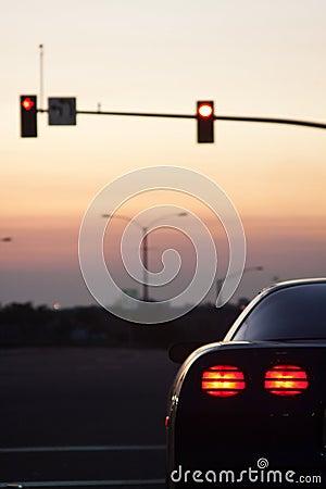 Sports car tail lights stop light