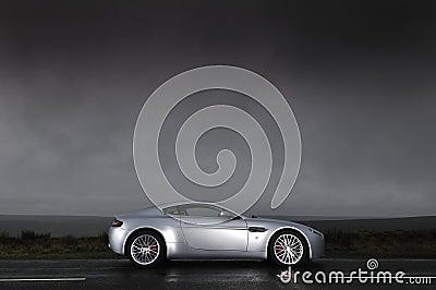 Sports car under stormy sky