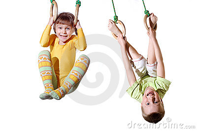 Sports children on gymnastic rings