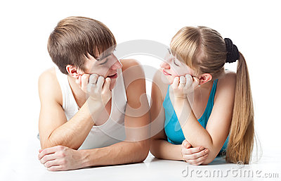 Sports couple is lying in the studio