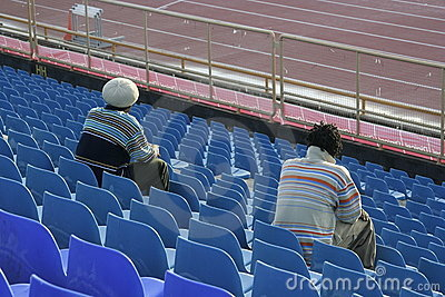 Sports fans in stadium seats