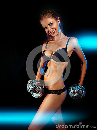 Sports female with dumbbells and toothy smile