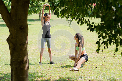 Sports, female friends relaxing after jogging