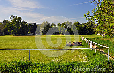 Sports field with roller