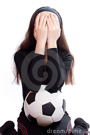 Sports girl with a football
