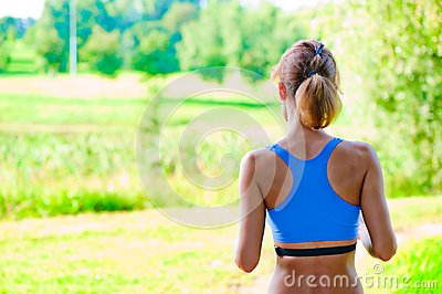 Sports girl runs in the morning in the park
