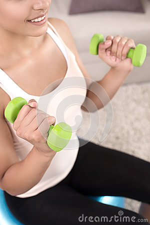 Sports at home. Top view of beautiful young women exercising at home