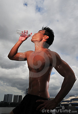 Sports Man quenching his thirst after a workout