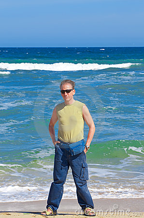 The sports man  standing  near  the sea