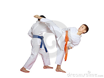 Sports paired exercises performed by athletes with blue and orange belt