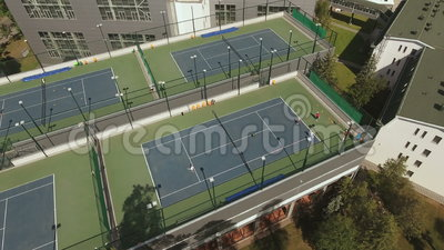 Sports People Spend A Leisure Time At The Tennis Court Stock Video