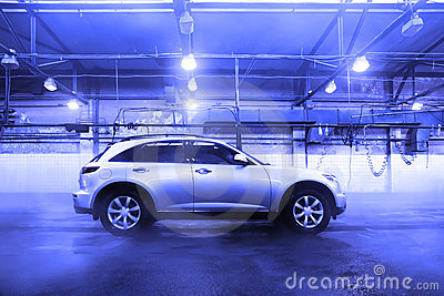 Sports utility vehicle at car wash is indoor
