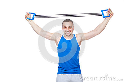 Sportsman doing fitness exercises with expander