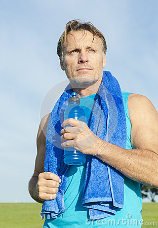 Sportsman holding water bottle.