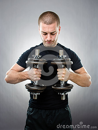 Sportsman lifting dumbbells