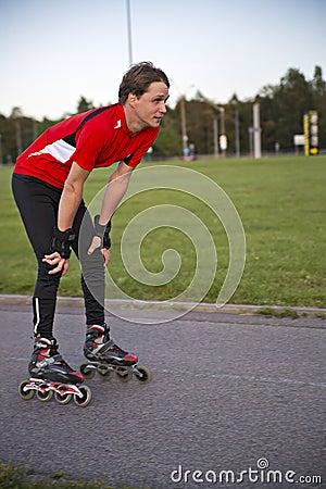 Sportsman on roller skates rest from tiring