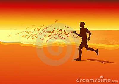 Sportsman running on the beach in the sunset