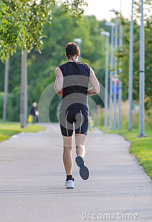 Sportsman running in park.
