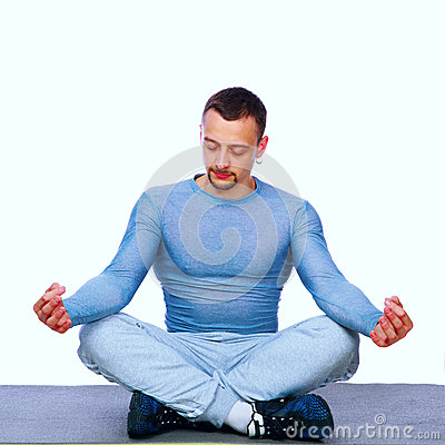 Sportsman sitting in the lotus position