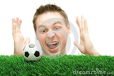 Sportsman or soccer fan screaming on the ball