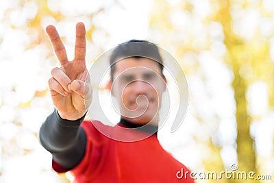 Sportsman victory symbol concept