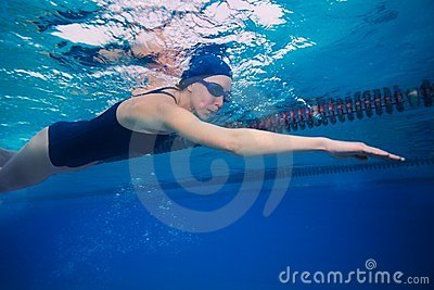 Sportsman woman swimming in crawl (stroke) style