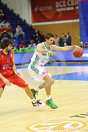 Sportsman from Zalgiris (Lithuania, in white) team with basketball Editorial Photo