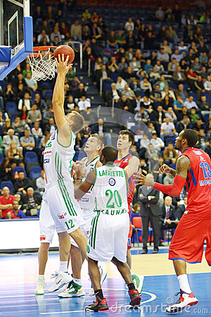 Sportsman from Zalgiris (Lithuania, in white) team throws ball Editorial Photography