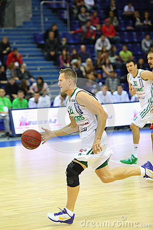 Sportsman from Zalgiris team runs basketball Editorial Photography