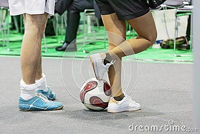 Sportsmen legs with football