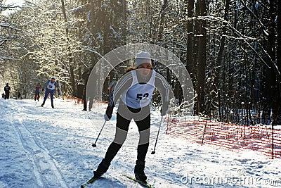 Sportsmen run on skis Editorial Stock Photo