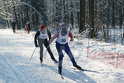 Sportsmen run on skis Editorial Photography