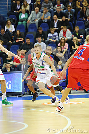 Sportsmen from Zalgiris and CSKA Moscow teams fight for basketball Editorial Image