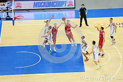 Sportsmen from Zalgiris and CSKA Moscow teams play basketball Editorial Photo